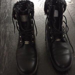 Black leather combat boots.